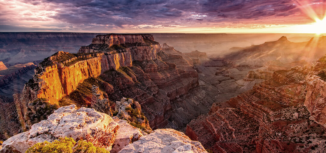 = A colorful morning sunrise above the Grand Canyon rocks in Arizona.