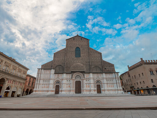 Daytime view of the Basilica di San Petronio, one of the largest churches in the world, found in Piazza Maggiore in Bologna, Italy.