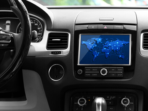 A finger touches the screen of a car's dashboard with a cloud on it
