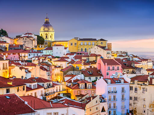 The beautiful view of red-roofed Lisbon from Portas do Sol lookout point in Alfama