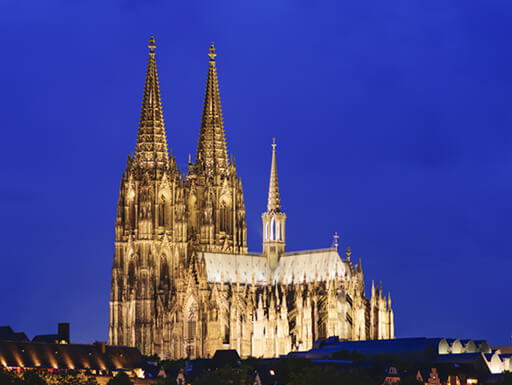 Gothic church Cologne Cathedral illuminated on a clear night