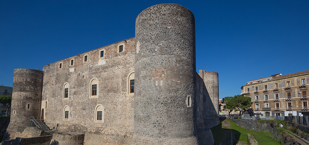 The exterior view of the medieval Castello Ursino on a clear afternoon in Catania, Italy.