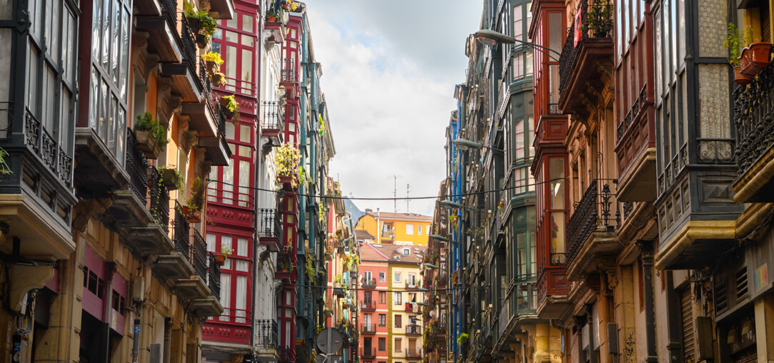 A daytime view of beautiful Old Town architecture in the Casco Viejo neighborhood of Bilbao, Spain.