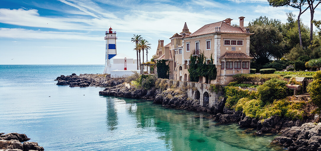 Santa Marta lighthouse and museum perched on the coastline in Cascais