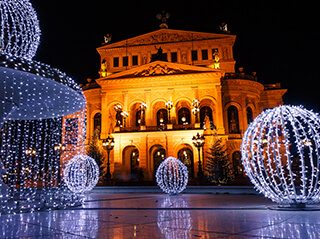 The Old Opera House and fountains by night, in Frankfurt, Germany