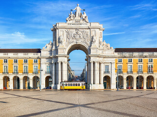 The city's grand gateway, Praça do Comércio, with its lavish statues and lemon-yellow facade
