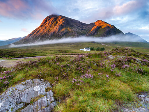 A beautiful sunrise over mountains in Glencoe in the Scottish Highlands.