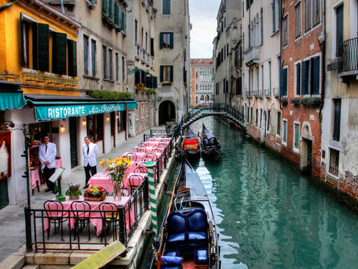 Colorful restaurants along a Venetian waterway