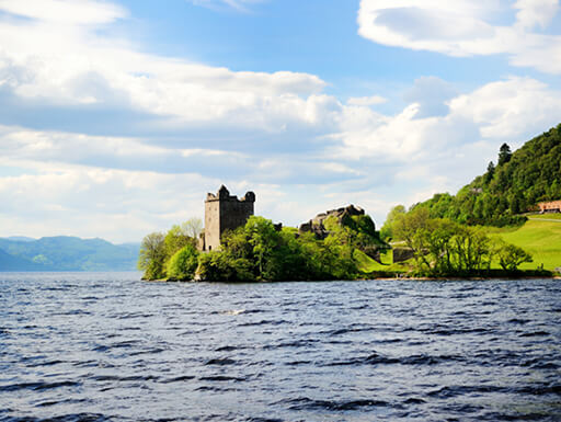 "=""A view across the famous water of Loch Ness with a glimpse of Urquhart Castle in the background."