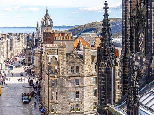 A view of the Royal Mile in Edinburgh, with the Firth of Forth behind it