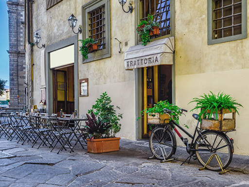 A pretty street in Florence, Italy, with a traditional trattoria