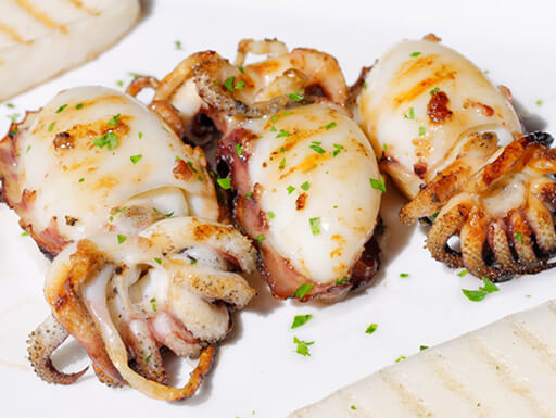 Fresh grilled squid topped with polenta