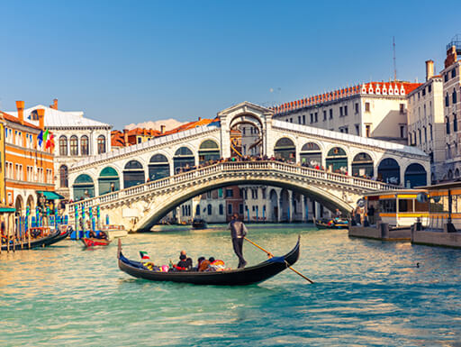 A gondola ride takes place near Rialto Bridge