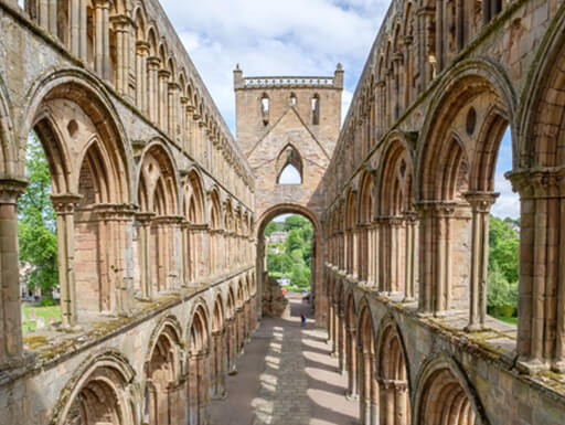 A walkway view of the gorgeous Jedburgh Abbey ruins.