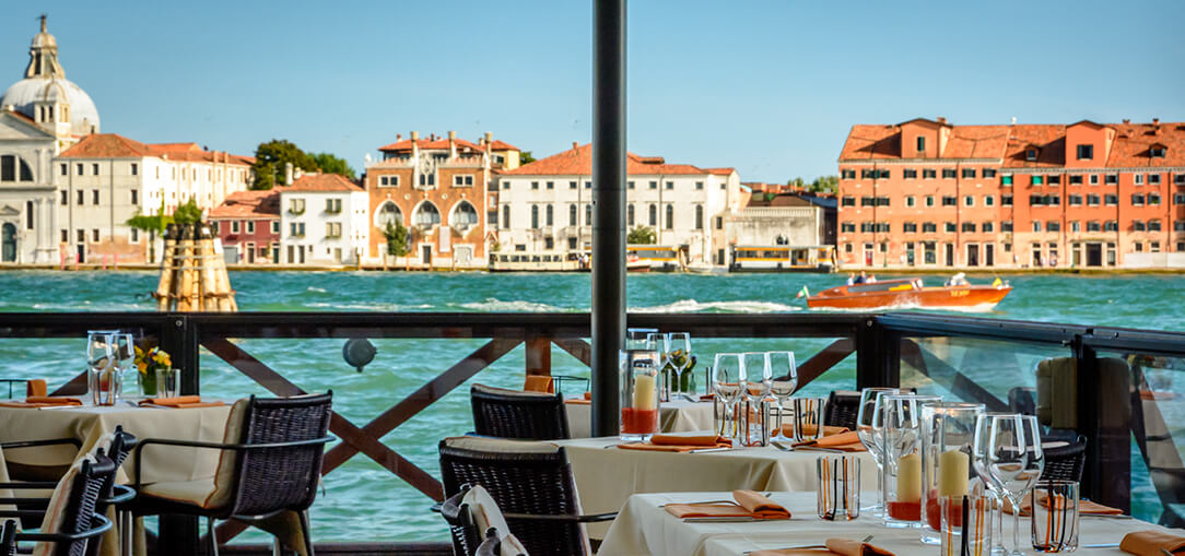 Dining tables in an outdoor restaurant in Venice, Italy