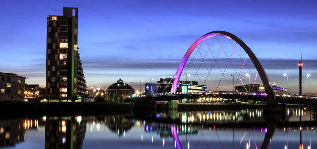 Clyde Arc and the River Clyde illuminated at night in Glasgow.